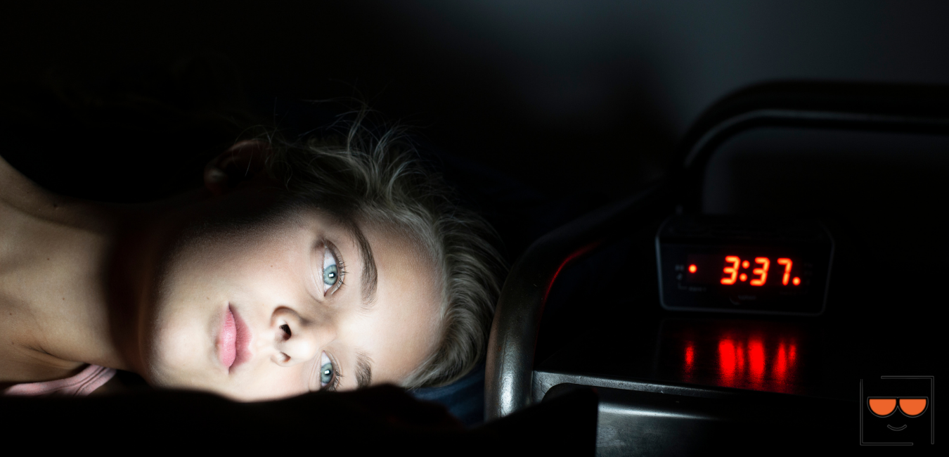 Girl looking at cell phone at 3:37 a.m.