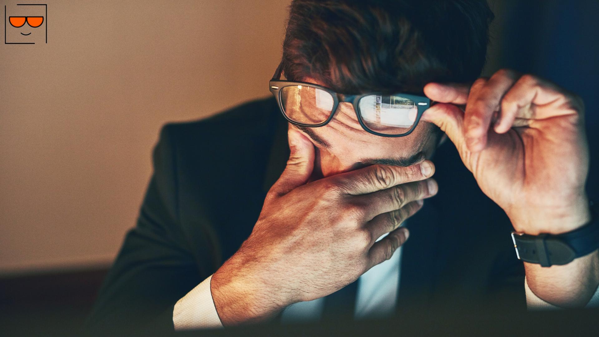 Man rubbing eyes due to eye strain