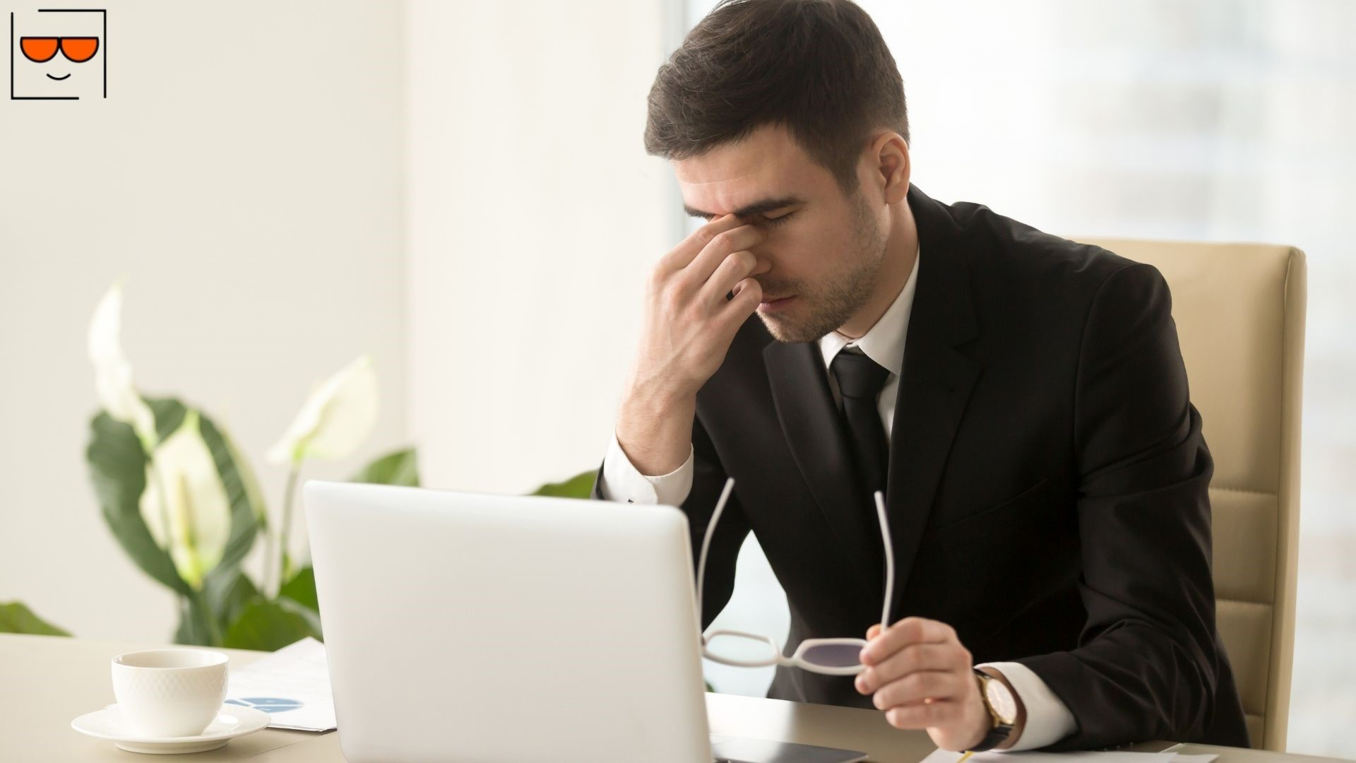 Man rubbing eyes due to eye strain from computer